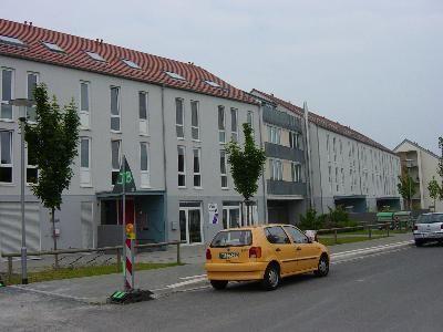 Mehrfamilienhaus und Geschäftsgebäude mit Tiefgarage in Darmstadt